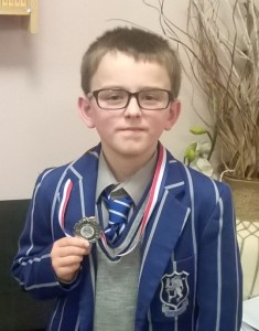 Kynan with his second place medal