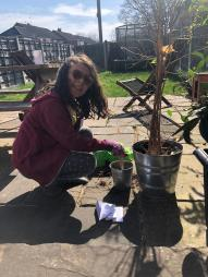 Maia planting her Gardening Club seeds